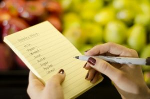Closeup of female hands going through shopping list